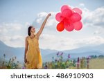 girl playing with red balloons... | Shutterstock . vector #486910903