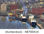 Offshore supply vessels in port. - stock photo
