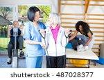 nurse assisting elder people in ... | Shutterstock . vector #487028377