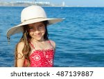 Cute Little Girl In Hat...