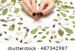 hands female with roses on a... | Shutterstock . vector #487342987