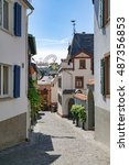 Small photo of Ruedesheim am Rhein (UNESCO World Heritage), Germany - 1st of August, 2015: Perspective of a traditional alleyway in small winemaking town of Southern Germany