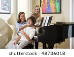family sitting on piano bench ... | Shutterstock . vector #48736018