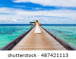 beautiful bride walking away on ... | Shutterstock . vector #487421113