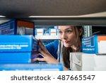 female mechanic picking up... | Shutterstock . vector #487665547