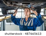 young female mechanic using... | Shutterstock . vector #487665613
