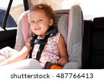 little girl in a car seat. | Shutterstock . vector #487766413