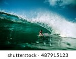 surfing girl riding a giant... | Shutterstock . vector #487915123