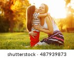 daughter kiss her mother on the ...   Shutterstock . vector #487939873