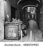 Small photo of JERUSALEM, ISRAEL - FEBRUARY 19, 2014: Fresh juice stall at Jerusalem old city narrow street. Old city has four quarters: Armenian Quarter, Christian Quarter, Muslim Quarter and Jewish Quarter.