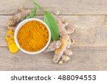 turmeric powder and turmeric in ... | Shutterstock . vector #488094553