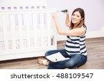 cute young pregnant woman using ... | Shutterstock . vector #488109547