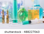 syringe with ampules of drugs | Shutterstock . vector #488227063