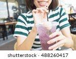 a girl drinking soda juice | Shutterstock . vector #488260417