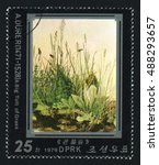 Small photo of NORTH KOREA - CIRCA 1979: A post stamp printed in North Korea shows A Big Tuft of Grass by Albrecht Durer, circa 1979