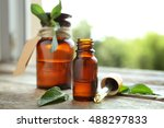 bottles with mint oil and fresh ... | Shutterstock . vector #488297833
