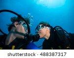 Couple Of Scuba Divers Kissing...