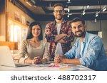 group of beautiful designers in ... | Shutterstock . vector #488702317