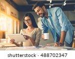 beautiful couple of designers...   Shutterstock . vector #488702347