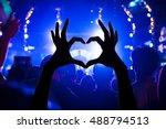 festival crowd raising hands in ... | Shutterstock . vector #488794513