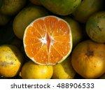 One Half Of A Cut Tangerine. O...