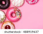 donuts with icing on pastel... | Shutterstock . vector #488919637