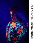 the girl in the neon light... | Shutterstock . vector #488977147
