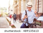 cheerful man standing in the... | Shutterstock . vector #489135613
