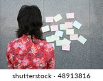 young woman considering an... | Shutterstock . vector #48913816