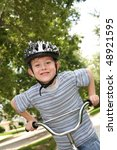 smiling boy on a bicycle | Shutterstock . vector #48921595