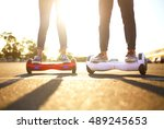 young man and woman riding on... | Shutterstock . vector #489245653
