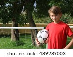 child with a soccer ball under... | Shutterstock . vector #489289003