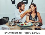 young couple sitting in a cafe... | Shutterstock . vector #489313423