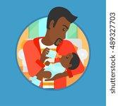 African American Father Feedin...