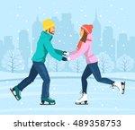 young man and woman skating on...