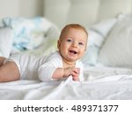 four months old baby with blue... | Shutterstock . vector #489371377