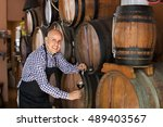 cheerful male wine maker taking ... | Shutterstock . vector #489403567
