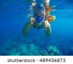 Snorkeling Woman Underwater...