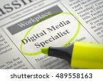 Stock photo digital media specialist vacancy in newspaper circled with a yellow marker blurred image 489558163