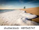 White Wave Foam On The Beach I...