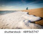 White Wave Foam On The Beach I...