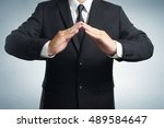 businessman in suit with two... | Shutterstock . vector #489584647