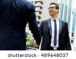 two businessmen shaking their... | Shutterstock . vector #489648037