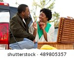 Couple Having A Picnic In The...