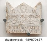 Small photo of Rome - August 14, 2016: Funerary stele of Lucinia Amias, one of the most ancient Christian inscriptions in Rome.It is characterized by the pagan consecration to the Gods Manes wit Christian symbolism