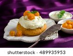 cream cake on a white saucer. a ... | Shutterstock . vector #489935953