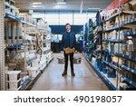 young handyman posing in a... | Shutterstock . vector #490198057