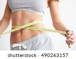 slim girl with centimeter on... | Shutterstock . vector #490263157