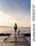 woman with dog enjoy sunrise... | Shutterstock . vector #490303747