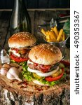 two burgers with mushrooms ... | Shutterstock . vector #490353367